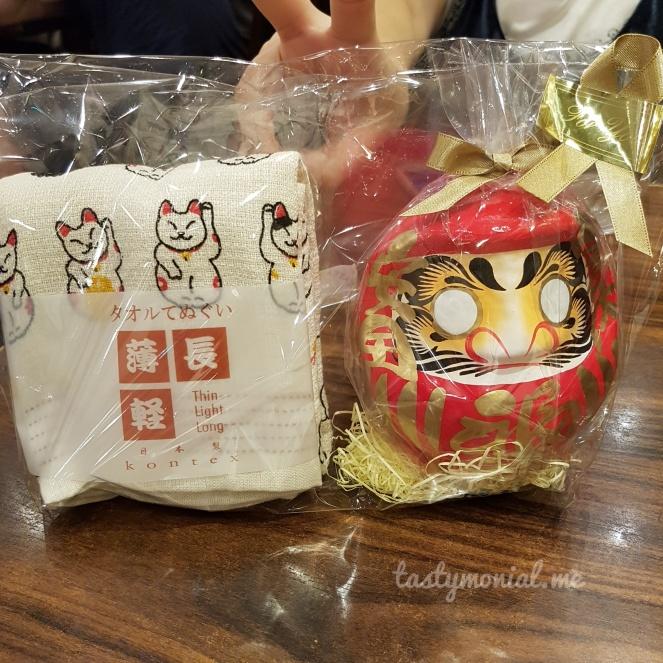 daruma doll and onsen towel